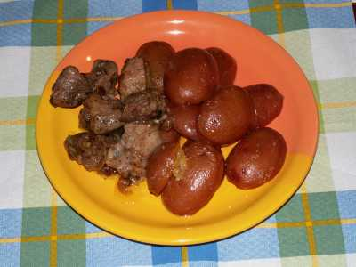 Baked potatoes with fried pork